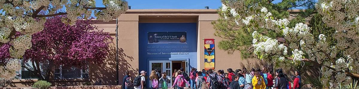 Students approach the front entrance of the Museum of International Folk Art.