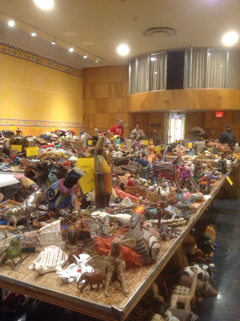 The auditorium is full to bursting with dnated items to be sold at the Flea
