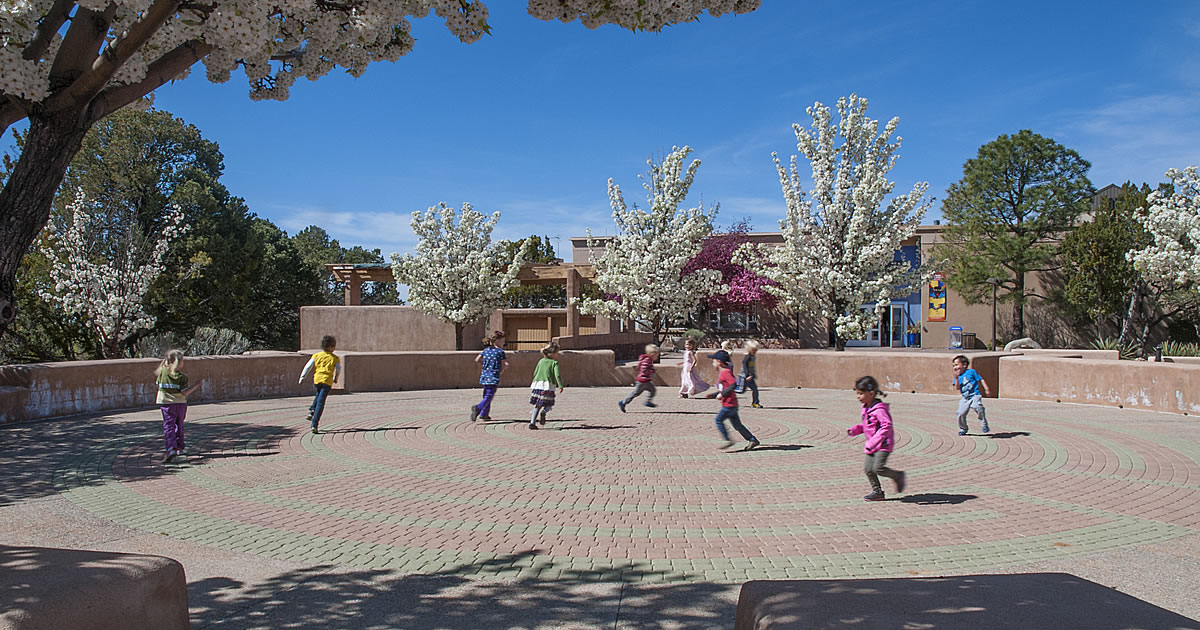 Children play in the labyrinth on Milner Plaza near the entrance to the museum.